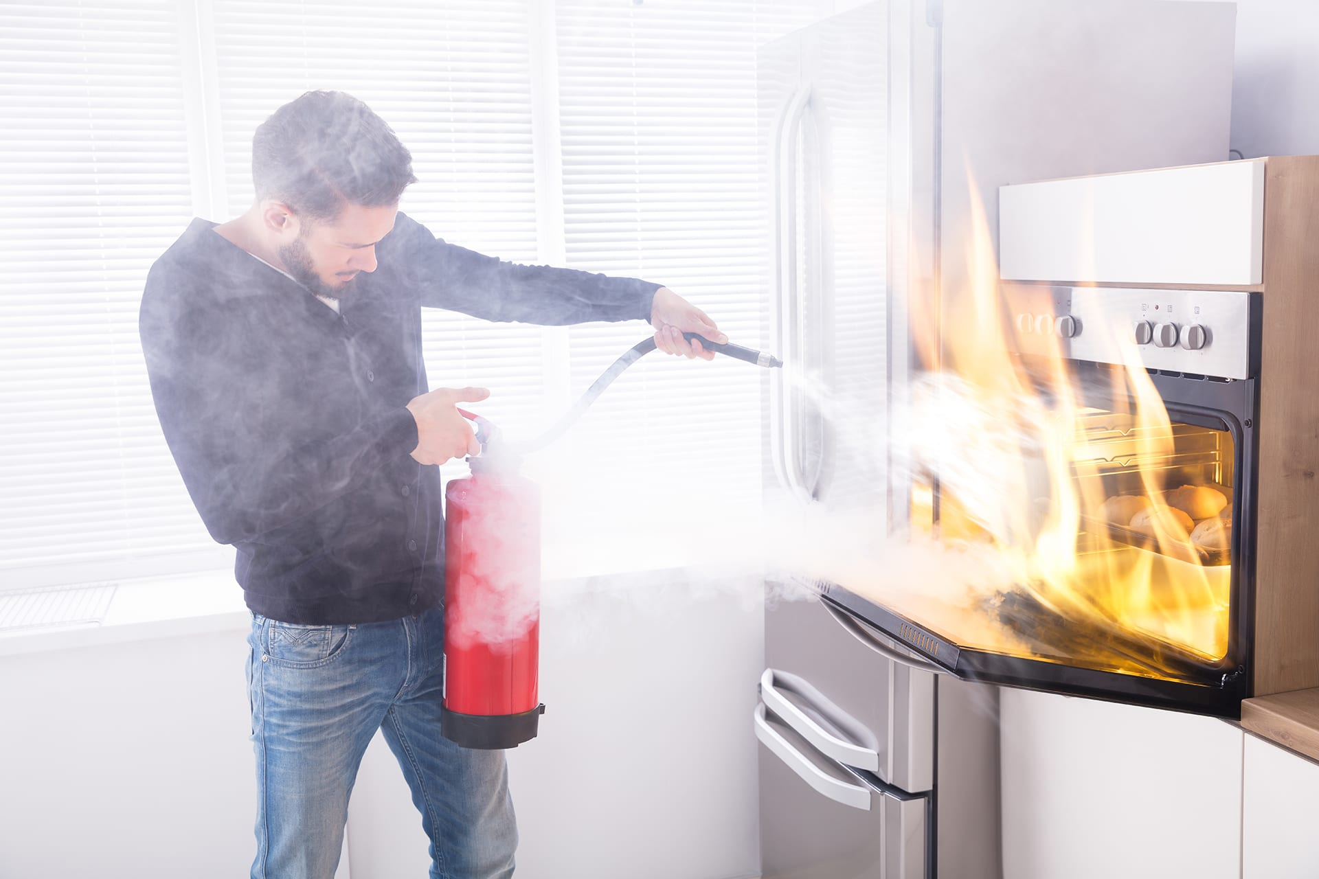 Men using fire extinguisher to stop fire